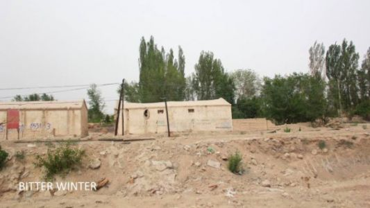 The demolished mosque was at the back side of the two houses in the image, approximately one-hundred meters from the road
