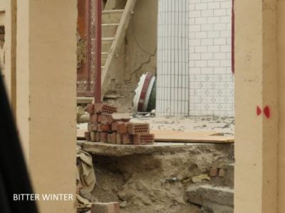 Courtyard in ruins, mosque roof pillars dismantled