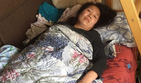 Beijing activist Li Meiqing rests in bed after suffering a caudal bone fracture from beatings by Chinese security officials as she and others tried to deliver food to Li Wenzu, wife of disappeared human rights lawyer Wang Quanzhang, April 12, 2018. Photo courtesy of an RFA listener.