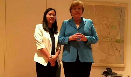 German Chancellor Angela Merkel and Xu Yan, wife of jailed human rights attorney Yu Wensheng, in undated recent photo. Xu Yan