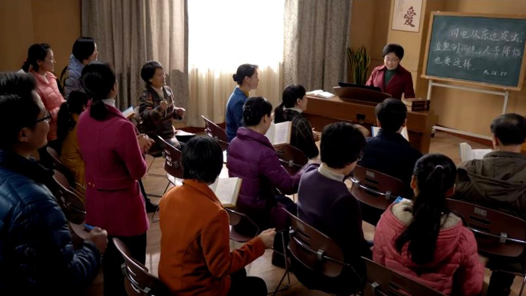 The believers of a church are playing the piano and singing hymns