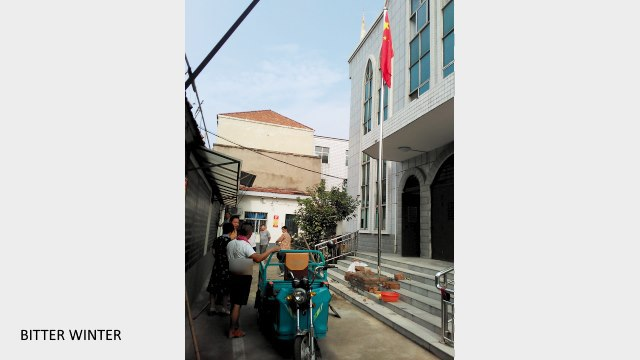 A Chinese flag is erected at a church in Xiguan village.
