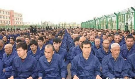 A photo posted to the WeChat account of the Xinjiang Judicial Administration shows Uyghur detainees listening to a speech at a re-education camp in Hotan prefecture's Lop county, April 2017. Wikipedia