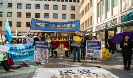 Multiple organizations rally in front of Cologne Cathedral to support the five demands of Hong Kong protest.