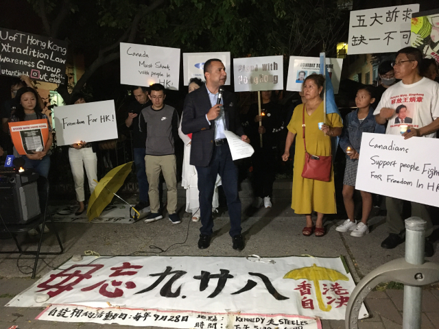 Over a dozen organizations hold a candlelight prayer rally in solidarity with Hong Kong.
