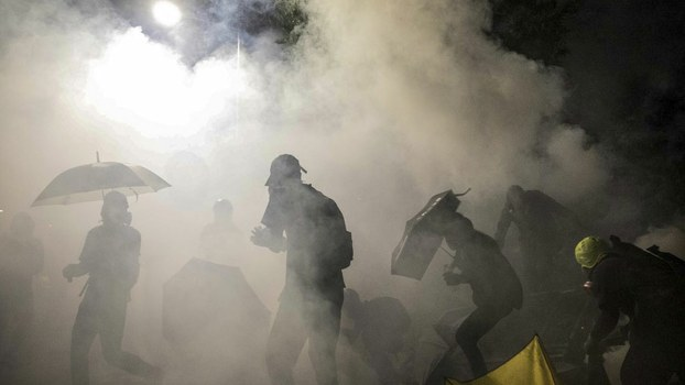Hong Kong Police Tear Gas University Chief in Campus Siege