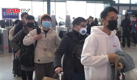 Passengers lining up in Wuhan railway station for their body temperature to be checked during the Wuhan coronavirus outbreak