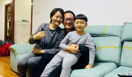 Wang Quanzhang (C), his wife Li Wenzu (L), and the couple's young son Wang Guangwei smile in Beijing during their first family reunion since Wang was released from prison this month after serving five years, April 27, 2020.