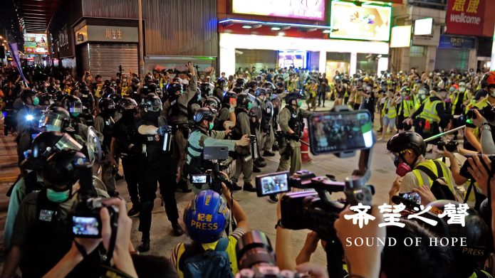 Riot Police Fire Tear Gas, Water Cannon at Angry Hong Kong Crowds