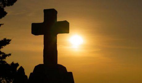 immortal cross in the setting sun