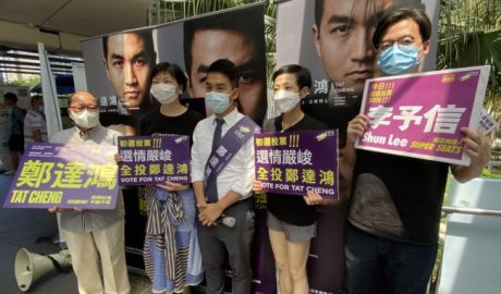 Pro-democracy activists (L-R) Eddie Chu, Gwyneth Ho, Leung Hoi-ching, Tiffany Yuen, Joshua Wong, Sunny Cheung and Lester Shum campaign during primary elections as Hong Kong's pro-democracy parties held weekend primary polls to choose candidates for upcoming legislative elections, July 12, 2020.