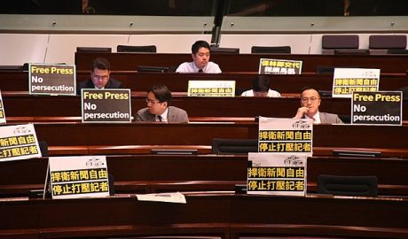 Many Democrats in Hong Kong put protest signs in front of their seats
