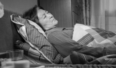 An elderly Christian bed ridden with serious illness