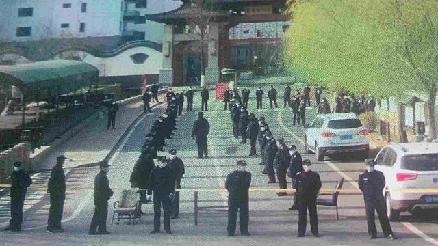 Nearly 100 police officers cordoned off the intersections leading to the Jiulong Temple.