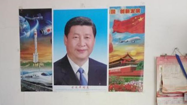 An impoverished Christian was forced to hang a portrait of Xi Jinping in his home.