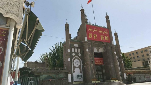Jama Mosque adorned with China's flag and propaganda banners that read 'Love the Party, Love the Country' in Kashgar prefecture's Kargilik county, in an undated photo.
