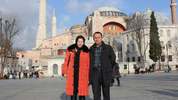 "Nurnisa Emet, younger sister of Ankara-based scholar Erkin Amet, and her husband Kadir Memet, during a 2013 tour of Turkey. Kadir Memet has been jailed for 23 years and his wife, for 14 years, for giving gifts to Erkin Amet that Chinese authorities said represented ""aiding and abetting terrorism."""
