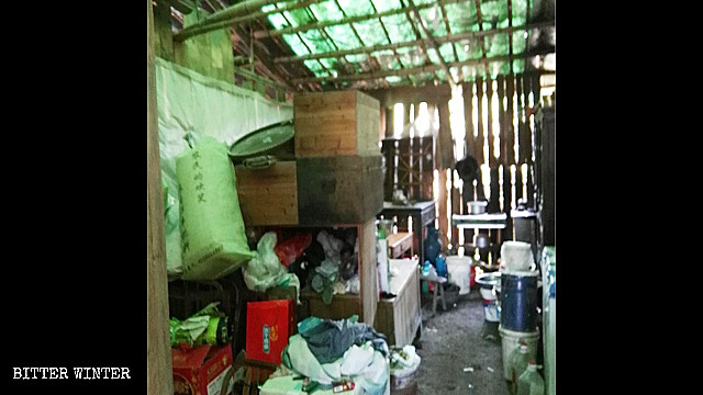 People's possessions piled in a bamboo shed.