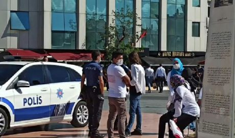 Police detain a group of Uyghurs on Taksim Square in Istanbul, Aug. 17, 2020
