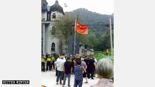 Security guards block the protesting congregation members.