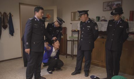 The policemen is arresting Christian.