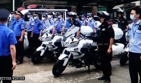 Police officers are getting ready for a raid.