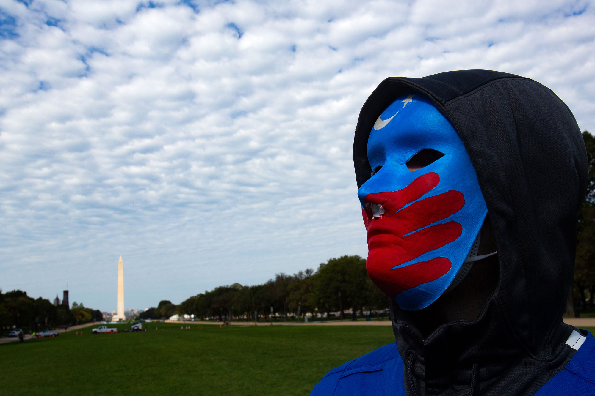 "A Uyghur protester participates in ""Resist CCP: Global Day of Action"" in front of the Capitol Reflecting Pool in Washington D.C., Oct. 1, 2020"