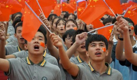 Ethnic minority students from Xinjiang attend a patriotic activity