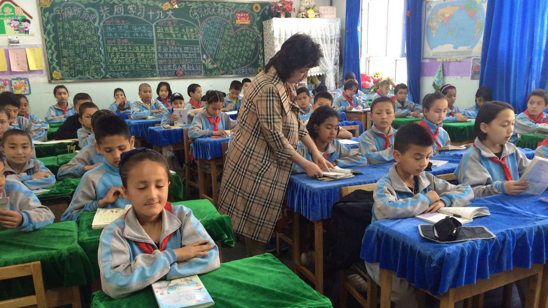 Qelbinur Sidik teaches elementary school children in Urumqi in an undated photo.