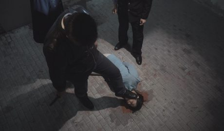 A christian was being tortured by Chinese policemen.