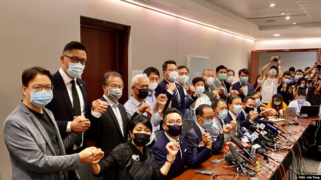Hong Kong's pro-democracy legislators pose for a photo before a press conference at Legislative Council in Hong Kong