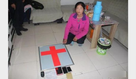 The police raid an Association of Disciples member's home in Qinghai Province in September last year.