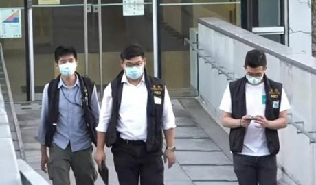 """Three members of Hong Kong's newly minted national security police raid the Chinese University of Hong Kong (CUHK) seeking """"evidence"""" that protesting students had broken a draconian national security law imposed on the city by Beijing, Nov. 20, 2020."""