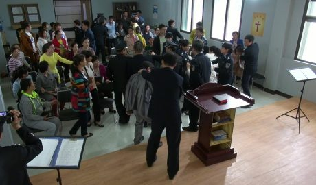 The policemen are arresting Christians during the meeting.