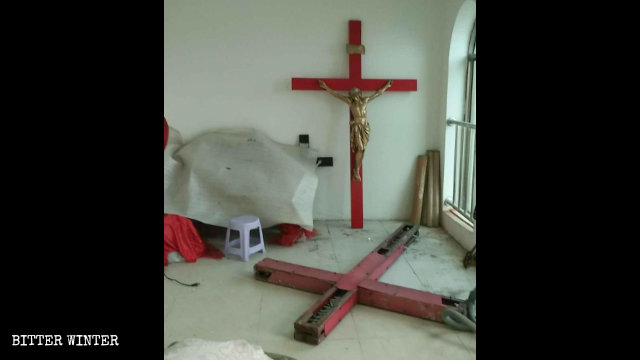 The removed crosses from the Xingdi village church were piled up in a corner.