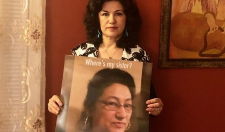 Rushan Abbas holds up a photo of her sister, Gulshan Abbas, in a photo posted to social media on Feb. 12, 2019.